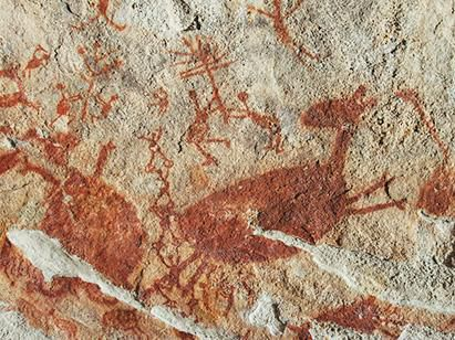 Pedra painting with red deer and humans